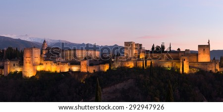 Beautiful Alhambra palace and surrounding mountains in Granada, Spain - stock photo