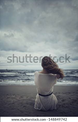 beautiful alone girl on the beach - stock photo