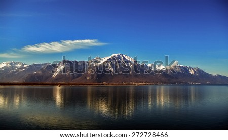 Beautiful Alps in front of Swiss lake Leman - stock photo
