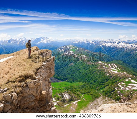Beautiful amazing day summer mountains. A man goes a sport hike in holidays. Nature background. Northern country Russia Caucasus wilderness unique. Rocky route. Blue sky. Inspiring leisure. - stock photo