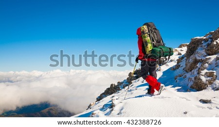 Beautiful amazing day winter mountains. A man goes a sport hike in snow holidays. Nature background. Northern country Russia Caucasus. Go to the aim.