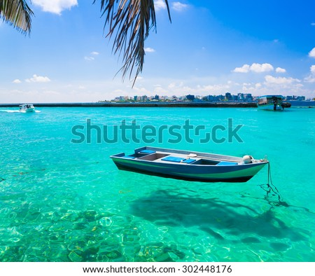 Beautiful amazing nature background. Boat in tropical blue sun sea. Luxury holiday resort. Island atoll about coral reef. Fresh  freedom. Adventure day. Snorkeling. Coconuts  unique - stock photo