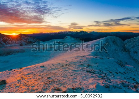 Beautiful amazing sunset.  Mountains in north country Russia Caucasus. Winter sunny landscape.
