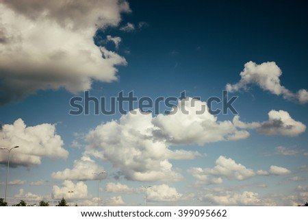 beautiful amazing view of sky and clouds on highway road near airport - stock photo