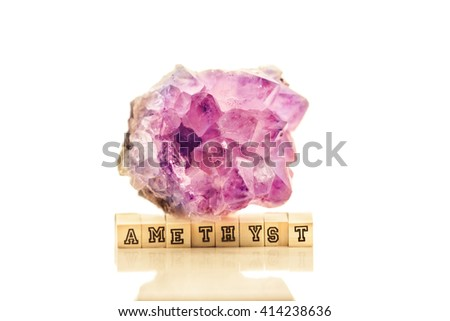 Beautiful amethyst druse close-up on white background - violet variety of quartz used for jewels - stock photo