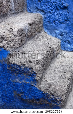 beautiful ancient steps and blue wall - stock photo