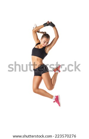 Beautiful and athletic girl jumping - stock photo