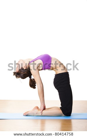 Beautiful and athletic young woman doing yoga exercises - stock photo
