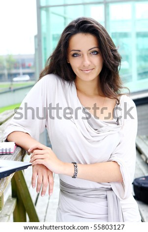 beautiful and attractive woman in park - stock photo