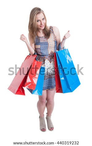 Beautiful and attractive woman with shopping bags looking excited and joyful isolated on white studio background