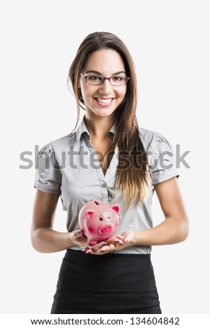 Beautiful and attractive young business woman smiling holding a piggy bank, isolated on white