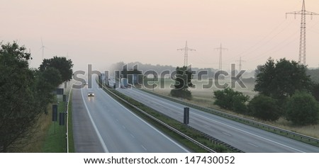 beautiful and calm highway mornings fog and the surrounding landscape - stock photo