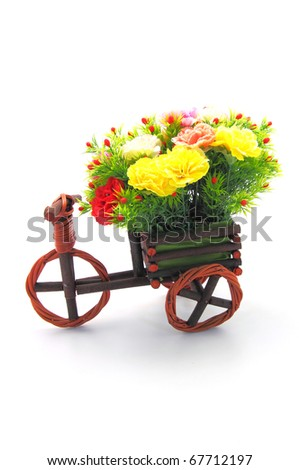 beautiful and colorful flower bouquet in wooden basket in car shape - stock photo
