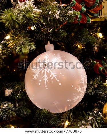 Beautiful and colorful holiday ornament decoration hanging on Christmas tree