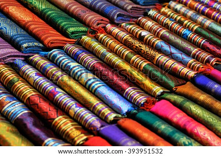 beautiful and colourful silk and cotton scarfs - stock photo