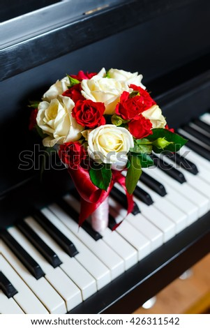 Beautiful and cute bridal bouquet lying on the piano