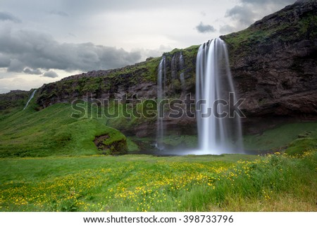 Beautiful and dramatic Seljalandsfoss waterfalls in Iceland - stock photo