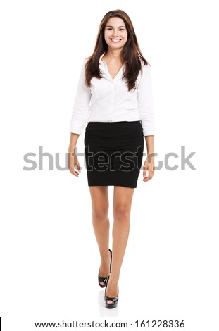 Beautiful and elegant hispanic business woman walking, over a white background
