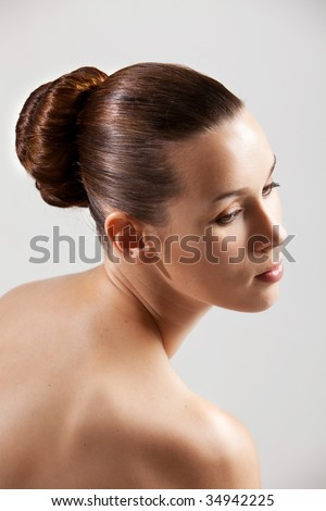 Beautiful and elegant woman with bare shoulders and stylish hair - stock photo