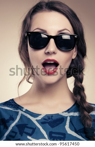 beautiful and fashion girl in sunglasses, close-up portrait, studio shot - stock photo