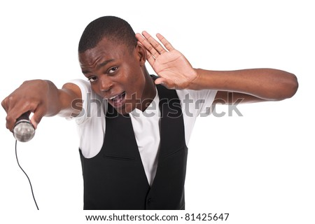 beautiful and handsome black man singing with hand on his ear - stock photo