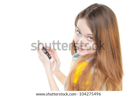 Beautiful and happy student girl standing isolated on white background. Smiling and looking into the camera. Casual style, modern smart phone in hands. - stock photo