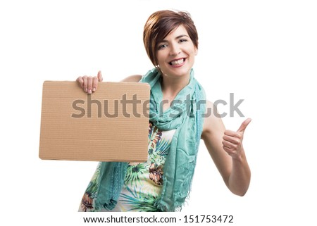 Beautiful and happy woman holding a cardboard and with thumbs up, isolated over a white background - stock photo