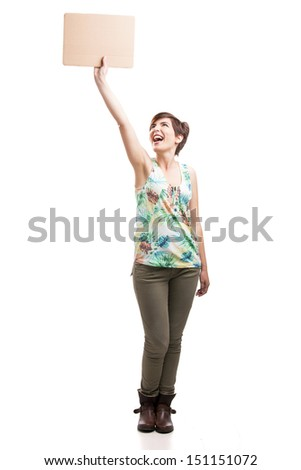 Beautiful and happy woman holding a cardboard, isolated over a white background - stock photo