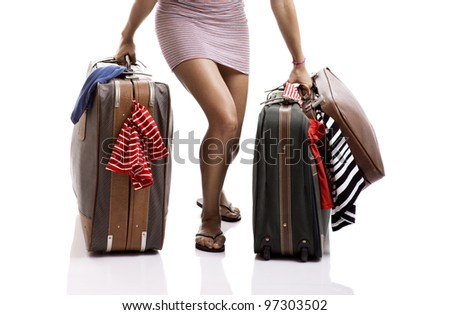 Beautiful and happy young woman carying the baggage with clothes - stock photo