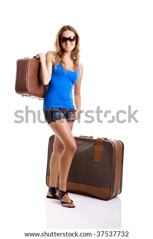 Beautiful and happy  young woman with old leather suitcases, isolated on white - stock photo