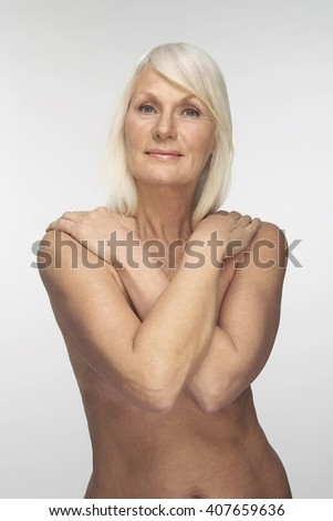 Beautiful and healthful old woman portrait shot in studio - stock photo