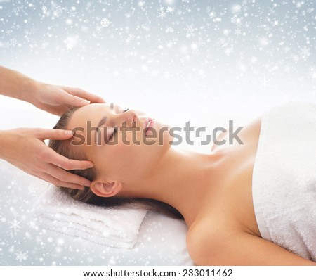 Beautiful and healthy woman in spa. Massage and healing. Winter concept. - stock photo