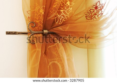Beautiful and modern curtains with an ornament - stock photo