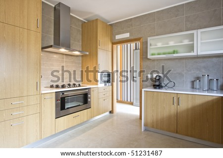 Beautiful and modern kitchen interior design in new home - stock photo