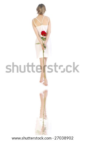Beautiful and romantic woman and her reflection isolated over white - stock photo