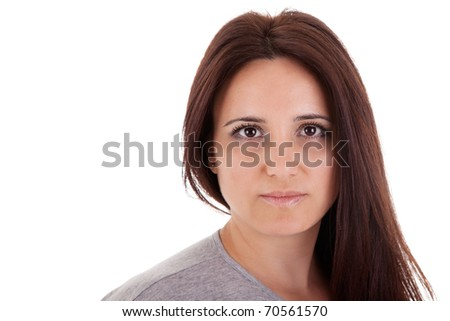 beautiful and serious middle-age woman, on white, studio shot - stock photo