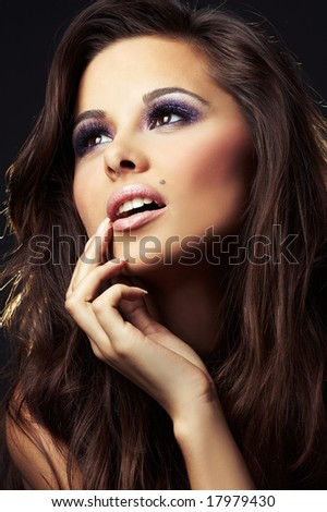beautiful and sexy brunette girl on dark background - portrait - stock photo