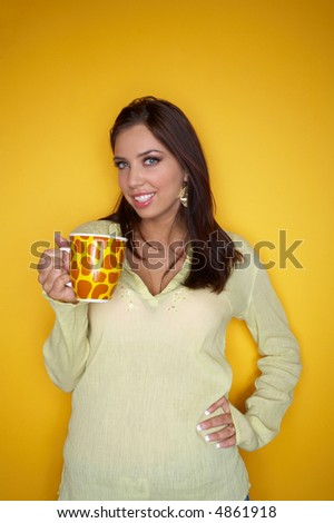 Beautiful and sexy brunette woman isolated on clear colour background with cup