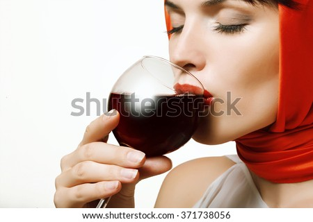 beautiful and sexy girl with a glass of red wine in hand, lips