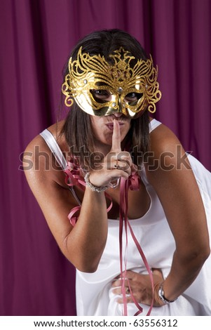 beautiful and sexy woman celebrating with a seductive mask (isolated on black) - stock photo