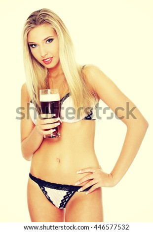 Beautiful and sexy woman holding glass of beer - stock photo