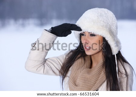 Beautiful and sexy woman in snowy winter outdoors - stock photo