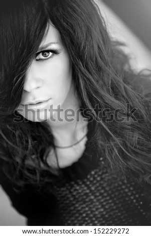 Beautiful and sexy woman on black white portrait