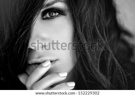 Beautiful and sexy woman on black white portrait - stock photo