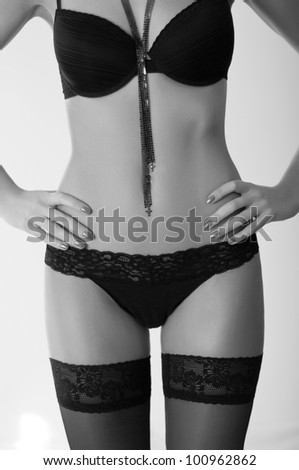 Beautiful and sexy woman wearing black lingerie - stock photo