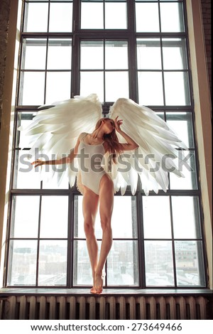 beautiful angel posing in studio - stock photo