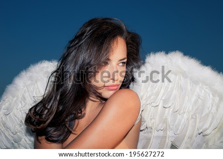 beautiful angel woman against blue sky - stock photo