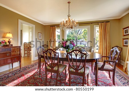 Beautiful antique dining room with greens and yellows