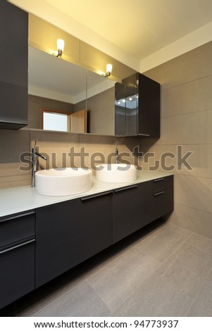 beautiful apartment, interior, bathroom, two sinks and mirror - stock photo