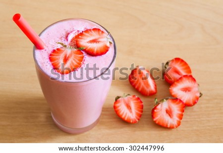 Beautiful appetizer strawberry fruit smoothie. Pink yogurt cocktail. Close up. Natural detox. Rustic style  - stock photo